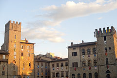 Medieval square in Arezzo (Tuscany, Italy). At evening royalty free stock photography