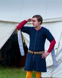 A medieval squire surveys the camp royalty free stock image