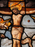 Medieval Stained Glass The Crucifixion. The Crucifixion of Christ shown in an image on a medieval 16th century stained glass panel Stock Photo