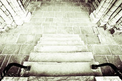 Medieval staircase. Monochrome image of a medieval stone staircase Royalty Free Stock Image