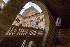 View through the arch to the stairs and courtyard of the Palazzo della Ragione Palazzo del Comune in Verona, Italy. Medieval stairs, built in 1447 in the Royalty Free Stock Photo