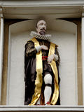 Medieval Statue. Of an Elizabethan Man displayed on an ancient Building Royalty Free Stock Image