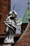 Medieval statue of an angel with a trumpet, Cremona, Italy Stock Photo