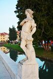 Medieval statue and river in Castelfranco Veneto, Treviso, Italy Stock Photography