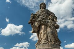 Medieval statue of a saint on the old Main bridge on the old Mai Royalty Free Stock Photo