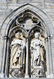 Medieval statues on the wall of Ypres Cloth Hall. In bright spring day royalty free stock photos