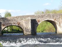A Medieval stone bridge crossing the River Exe in Bickleigh village, Devon, England, UK. On a summers day Stock Images