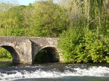 A Medieval stone bridge crossing the River Exe in Bickleigh village, Devon, England, UK. On a summers day Stock Image