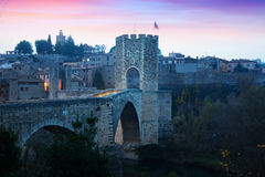 Medieval stone bridge with gate, built in 12th century. Besalu Royalty Free Stock Photography