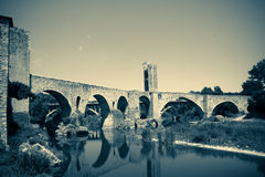 Medieval stone bridge. Imitation of old image Stock Images