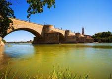 Medieval stone bridge over Ebro river in Zaragoza Royalty Free Stock Photos