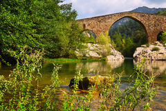 Medieval stone bridge over Llobregat river in  Pyrenees. Catalonia Royalty Free Stock Image