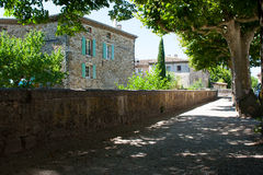 A medieval stone building in a mountain village in the Drome region of France. Set in the shade of a typical village street Stock Image