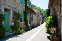 Medieval stone building in a narrow street in a mountain village in the Drome region of France. Medieval stone buildings in a mountain village in the Drome Royalty Free Stock Photography