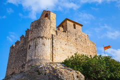 Medieval stone castle and flag of Catalonia, Spain Stock Photography