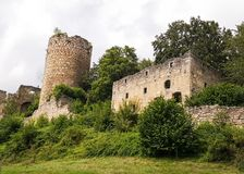 A medieval stone castle ruins on top of a hill in Austria. A medieval stone castle ruins on top of a hill in Upper-Austria with trees Royalty Free Stock Image