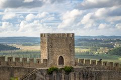 Medieval stone castle tower and walls close up with landscape and blue sky. stock photos