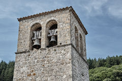 A medieval stone church belfry Royalty Free Stock Image