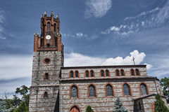 Medieval, stone church witch clocktower Stock Images