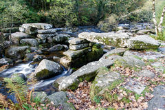 Medieval stone Clapper Bridge, Dartmoor England. Stock Images