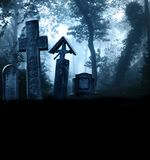 Medieval stone crosses and tombstones, cemetery in misty forest Royalty Free Stock Image