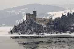 Medieaval castle in Niedzica in Poland in wintertime. Medieval stone defence castle on a hill in Niedzica in mountains in southern Poland during winter time stock image