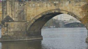 Medieval Stone Foot Bridge. Medieval stonework footbridge view over river stock footage