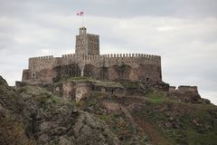 Medieval stone fortress on the top mountaine stock image