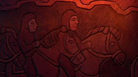 Men On Horseback Ancient Stone Carving In Fire Light
