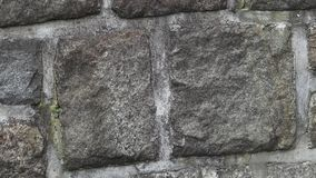 Medieval stone wall. A masonry wall. Stone wall texture background stock footage