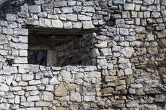 Medieval stone wall with a window Royalty Free Stock Photography