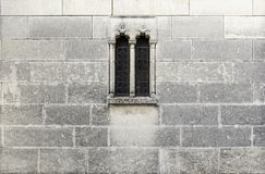Medieval stone window. Detail of a stone wall Stock Photo