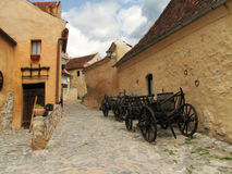 Medieval street. Street in medieval stronghold with two carriages Stock Image