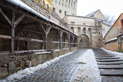 Medieval street. An old street in the medieval citadel from Sighisoara, Romania during winter Stock Images