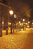 Medieval street in Amsterdam Netherlands by night Royalty Free Stock Photos