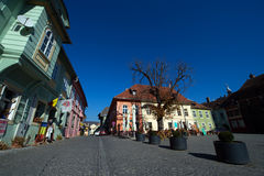 Medieval street with cafe bar and shops in Sighisoara city Royalty Free Stock Photography