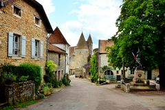 Medieval street with castle, Chateauneuf, Burgundy, France. View down a medieval street to the castle at Chateauneuf, Burgundy, France Stock Image
