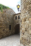 Medieval street in Catalonia Royalty Free Stock Images