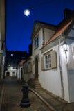 Medieval street at dusk in Riga, Latvia Royalty Free Stock Photo