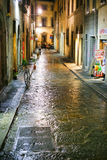 Medieval street in Florence Italy at night Royalty Free Stock Image