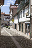 Medieval street of the Historical Center of Guimaraes. Stock Images