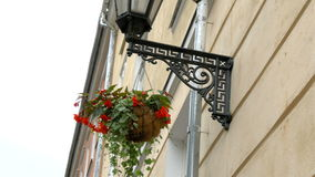 A medieval street lamp and a hanging plant at Estonia GH4 4K stock video footage