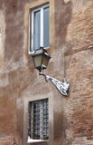 Medieval street lamp in wintertime. Rome, Italy Royalty Free Stock Photos