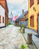 Medieval street leading to the temple, Latvia Royalty Free Stock Photography