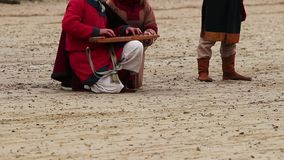 Medieval street musicians playing ancient musical instrument at city square. Stock footage stock video