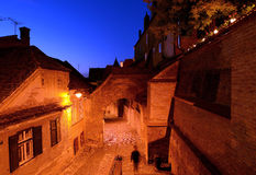 Medieval street at night in Sibiu Royalty Free Stock Images