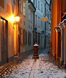 Medieval street in the old city of Riga in winter, Latvia Royalty Free Stock Photo