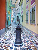 Medieval street in the old city of Riga in winter, Latvia Royalty Free Stock Images