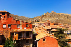 Medieval street with old fortress wall in Albarracin Stock Photos
