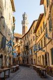 Medieval street and old houses in Siena, Italy Stock Photography